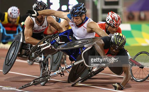 Alhassane Balde of Germany collides with Julien Casoli of France during the men's 1500m T54 heats during the Evening Session on Day Two of the IPC...