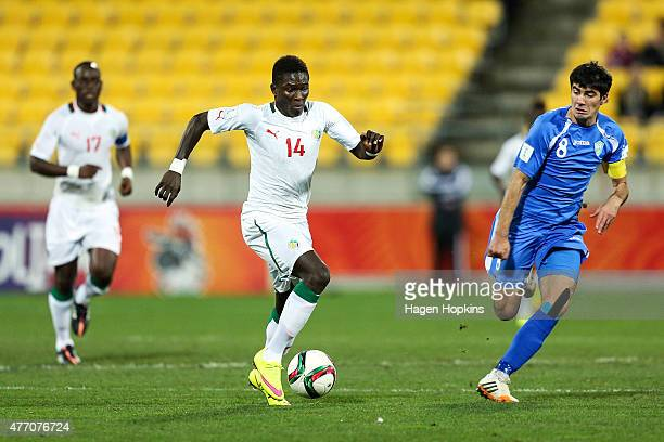 Alhassane Sylla of Senegal makes a break from Javokhir Sokhibov of Uzbekistan during the FIFA U20 World Cup New Zealand 2015 quarterfinal match...