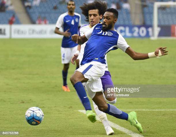 AlHilal's Abdullah Al Zori vies for the ball with AlAin's Omar Abdulrahman during their AFC Asian Champions League Group C football match at the King...