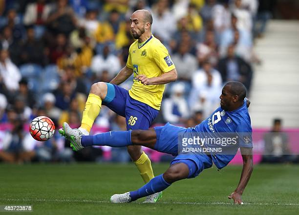 AlHilal's Brazilian defender Digao tackles AlNassr's Polish midfielder Adrian Mierzejewski during the Saudi Super Cup between AlNassr and AlHilal at...