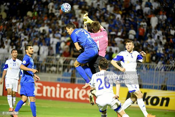 AlHilal's Carlos Eduardo fights for the long ball with Pakhtakor's Nikita Ribkin during their Asian Champions League football match at Prince Faisal...