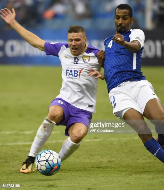 AlHilal's defender Abdullah Zori vies for the ball with AlAin's player Marcus Berg during their AFC Asian Champions League Group C football match at...