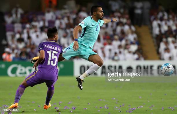 AlHilal's defender Mohammed AlBreik vies for the ball with AlAin's defender Khaled Abdulrahman during their AFC Asian Champions League Group C...