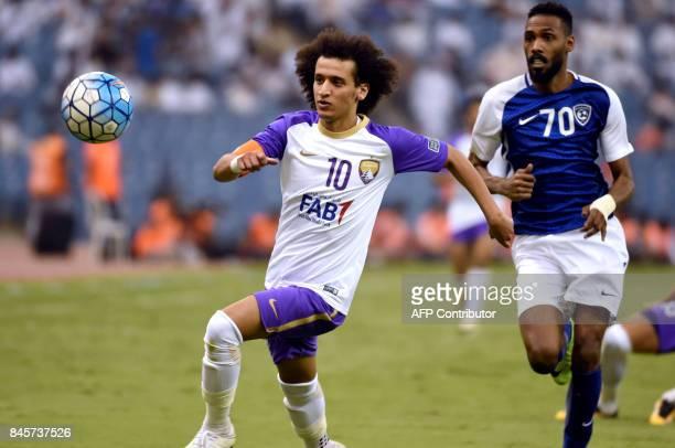 AlHilal's defender Mohammed Jahfali vies for the ball with AlAin's Omar Abdulrahman during their AFC Asian Champions League quarterfinal second leg...