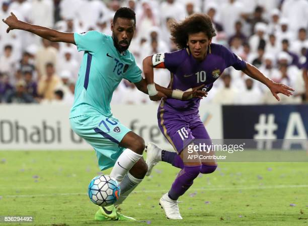 AlHilal's defender Mohammed Jahfali vies for the ball with AlAin's midfielder Omar Abdulrahman during their AFC Asian Champions League Group C...