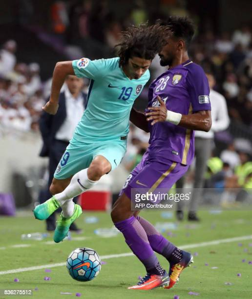AlHilal's defender Mohanad Salem vies for the ball with AlAin's defender Mohamed Ahmed during their AFC Asian Champions League Group C football match...