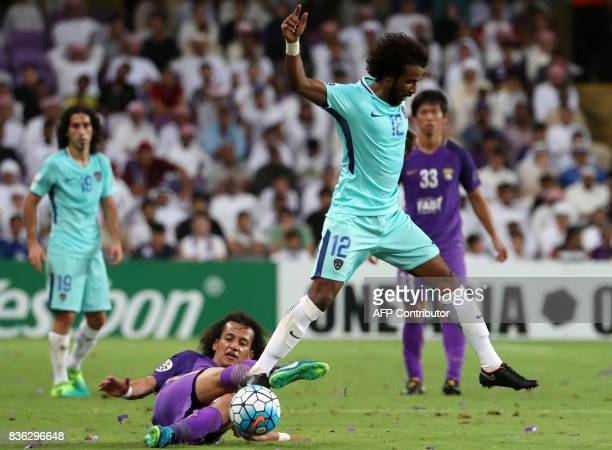 AlHilal's defender Yasser AlShahrani is tackled by AlAin's midfielder Omar Abdulrahman during their AFC Asian Champions League Group C football match...