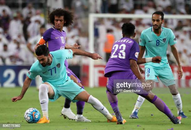 AlHilal's forward Omar Khribin vies for the ball with AlAin's captain Omar Abdulrahman and defender Mohamed Ahmed during their AFC Asian Champions...