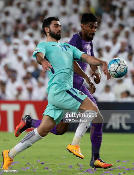 AlHilal's forward Omar Khribin vies for the ball with AlAin's defender Mohamed Ahmed during their AFC Asian Champions League Group C football match...