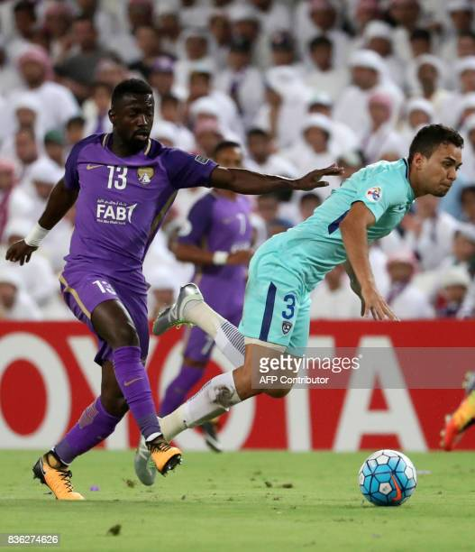 AlHilal's midfielder Carlos Eduardo is tackled by AlAin's midfielder Ahmed Barman during their AFC Asian Champions League Group C football match at...