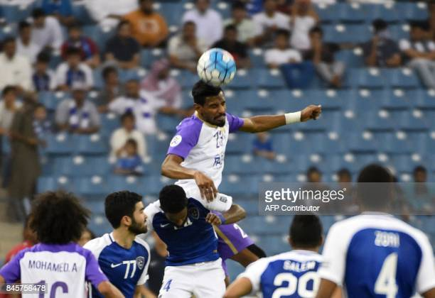 AlHilal's Nawaf Al Abid vies for the ball with AlAin's Mohamed Ahmed during their AFC Asian Champions League Group C football match at the King Fahad...