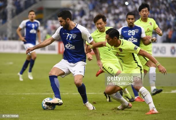 AlHilal's Omar Khrbin vies for the ball against Urawa Reds' Tomoya Ugajin during the Asian Champions League final football match between Saudi...