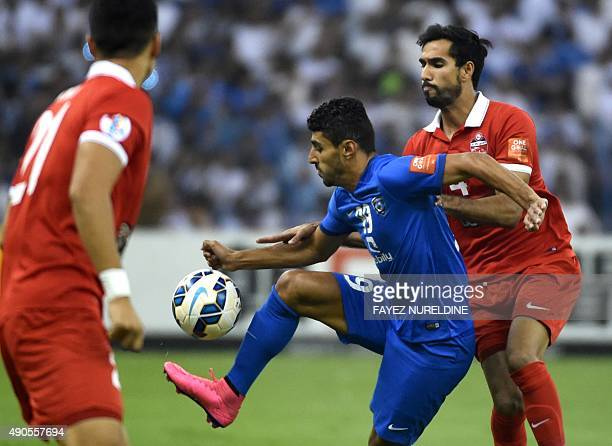 AlHilal's player Ailton Jose Almeida fights for the ball against UAE's AlAhli player Habib alFardan during their AFC Champions League semifinal...