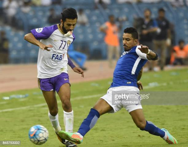 AlHilal's player Salem Al Dosari vies for the ball with AlAin's player Bandar Al Harbi during their AFC Asian Champions League Group C football match...