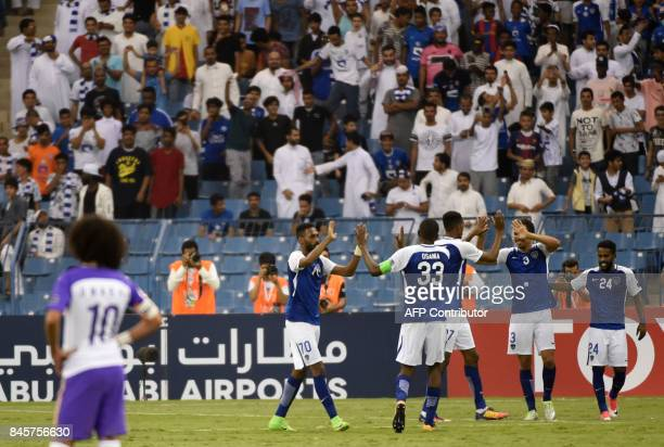 AlHilal's players celebrate after winning against AlAin's during their AFC Asian Champions League Group C football match at the King Fahad Stadium in...