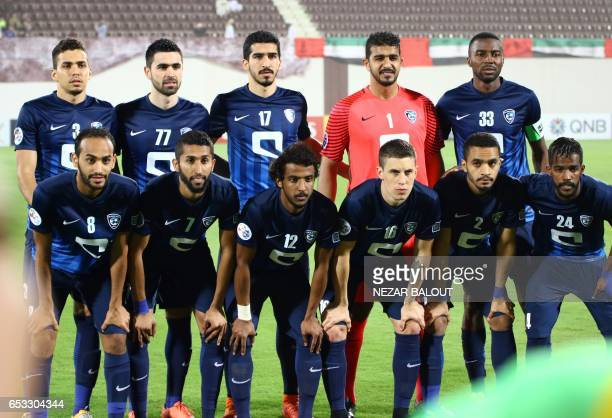 AlHilal's players pose prior to the AFC Champions League group D football match between UAE's AlWahda and Saudi Arabia's AlHilal at AlNahyan Stadium...
