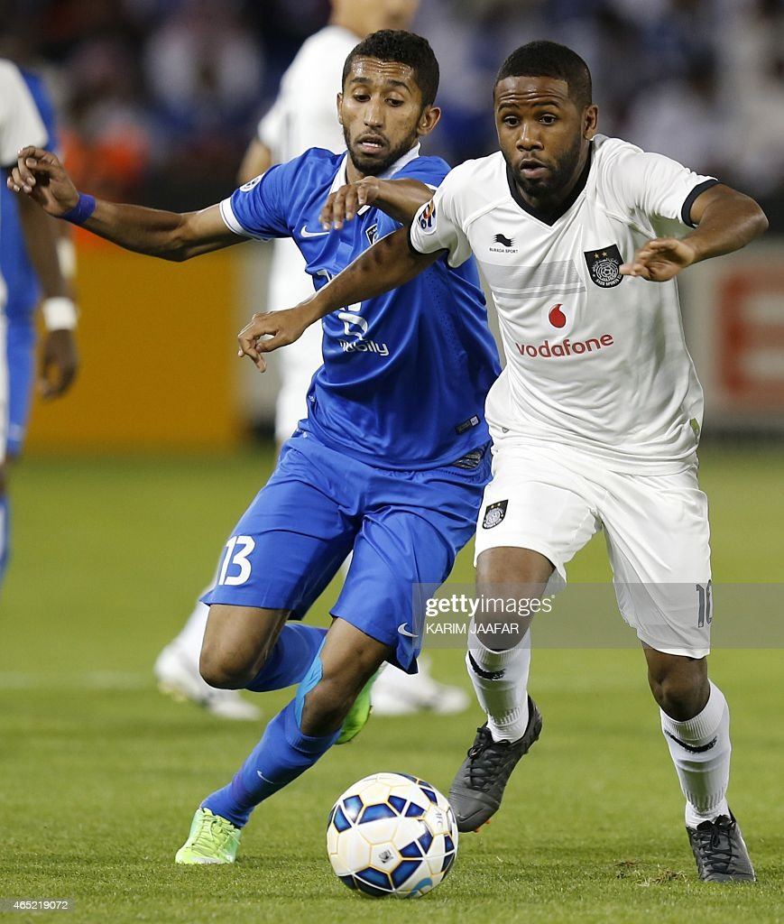 Al-Hilal's Salman Al-Faraj (L) vies with al-Sadd's Khalfan Ibrahim during the AFC champions league Group C football match Qatar's al-Sadd versus Saudi Arabia's al-Hilal at Jassim Bin Hamad Stadium in Doha on March 4, 2015.