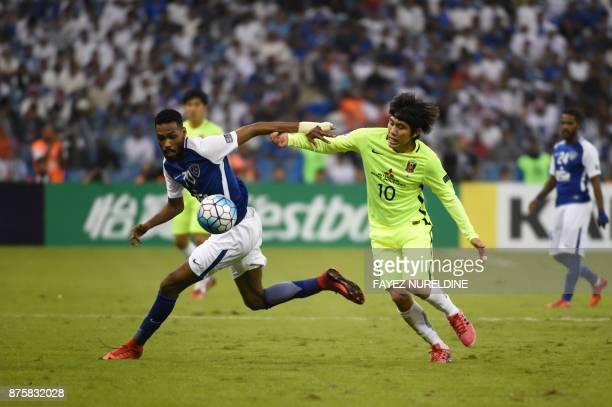 AlHilal's Saudi defender Mohammed Jahfali vies for the ball with Urawa Reds' Japanese forward Yosuke Kashiwagi during the Asian Champions League...