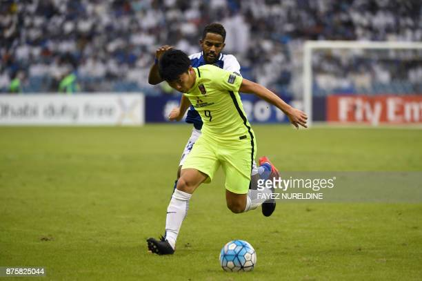 AlHilal's Saudi midfielder Nawaf Al Abed marks Urawa Reds' Japanese forward Yuki Muto during the Asian Champions League final football match between...