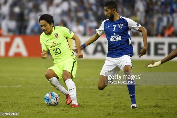 AlHilal's Saudi midfielder Salman AlFaraj marks Urawa Reds' Japanese forward Shinzo Koroki during the Asian Champions League final football match...