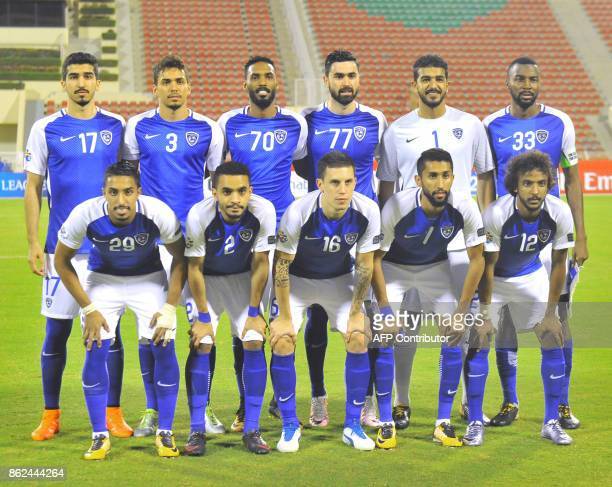 AlHilal's starting eleven pose for a group shot ahead of the Asian Champions League semifinal football match between Persepolis and AlHilal at the...