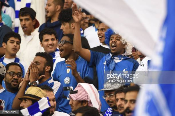 AlHilal's supporters cheer for their team during the Asian Champions League final football match between Saudi Arabia's AlHilal and Japan's Urawa...