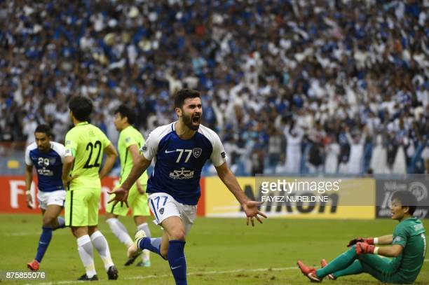 AlHilal's Syrian forward Omar Khribin celebrates scoring his first goal and his team's equaliser during the Asian Champions League final football...