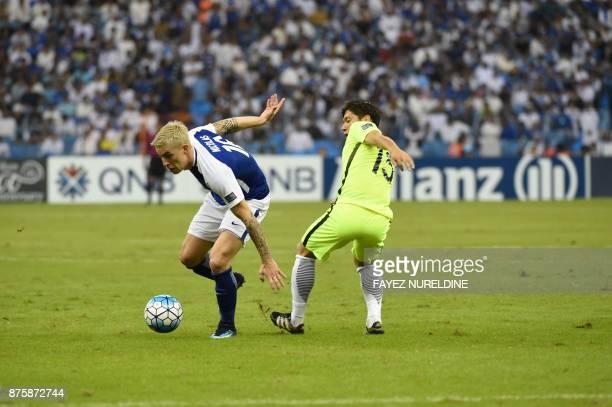 AlHilal's Uruguayan midfielder Nicolas Milesi vies for the ball with Urawa Reds' forward Toshiyuki Takagi during the Asian Champions League final...