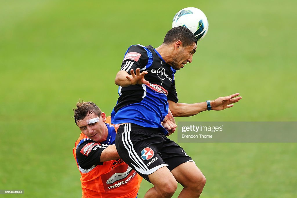Ali Abbas and Sebastian Ryall of Sydney compete for a header during a Sydney FC A-League training session at Macquarie Uni on November 15, 2012 in Sydney, Australia.