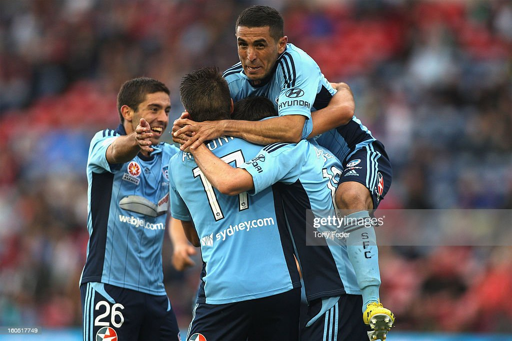 Ali Abbas (R) of Sydney celebrates with his team mates after a Sydney goal during the round 19 A-League match between the Newcastle Jets and Sydney FC at Hunter Stadium on February 2, 2013 in Newcastle, Australia.