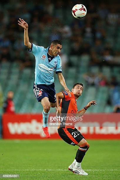 Ali Abbas of Sydney competes with Dimitri Petratos of the Roar during the round 12 ALeague match between Sydney FC and Brisbane Roar at Allianz...