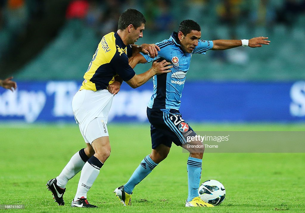 Ali Abbas of Sydney competes with Nick Montgomery of the Mariners during the round 13 A-League match between Sydney FC and the Central Coast Mariners at Allianz Stadium on December 27, 2012 in Sydney, Australia.