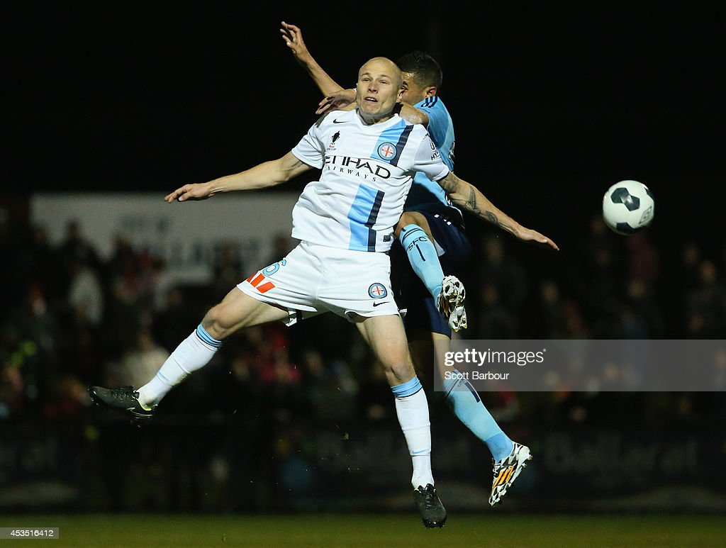 Ali Abbas of Sydney FC and <a gi-track='captionPersonalityLinkClicked' href=/galleries/search?phrase=Aaron+Mooy&family=editorial&specificpeople=6342712 ng-click='$event.stopPropagation()'>Aaron Mooy</a> of City compete for the ball during the FFA Cup match between Melbourne City and Sydney FC at Morshead Park Stadium on August 12, 2014 in Ballarat, Australia.