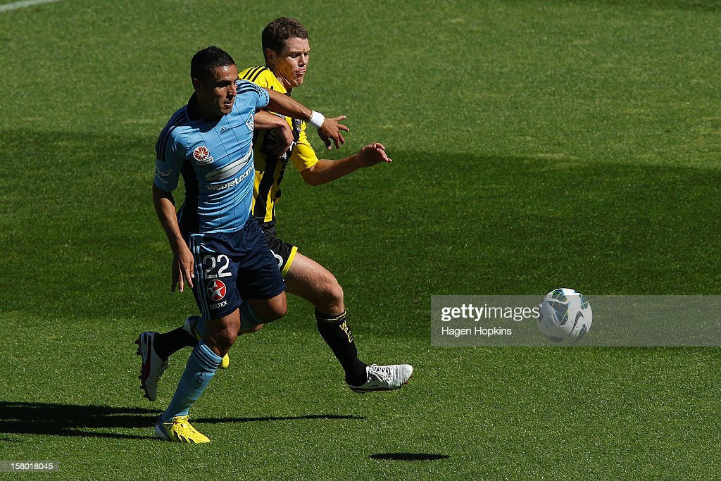 Ali Abbas of Sydney FC competes for the ball with Tony Lochhead of the Phoenix during the round 10 A-League match between Wellington Phoenix and Sydney FC at Westpac Stadium on December 9, 2012 in Wellington, New Zealand.