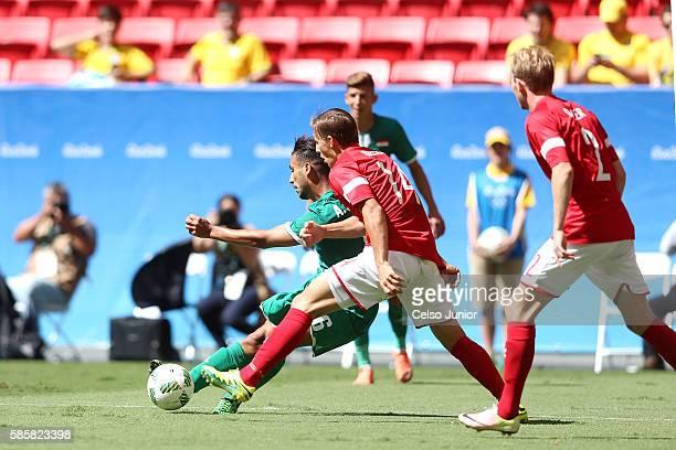 Ali Adnan of Iraq and Casper Nielsen of Denmark vie for the ball at Mane Garrincha Stadium on August 4 2016 in Brasilia Brazil