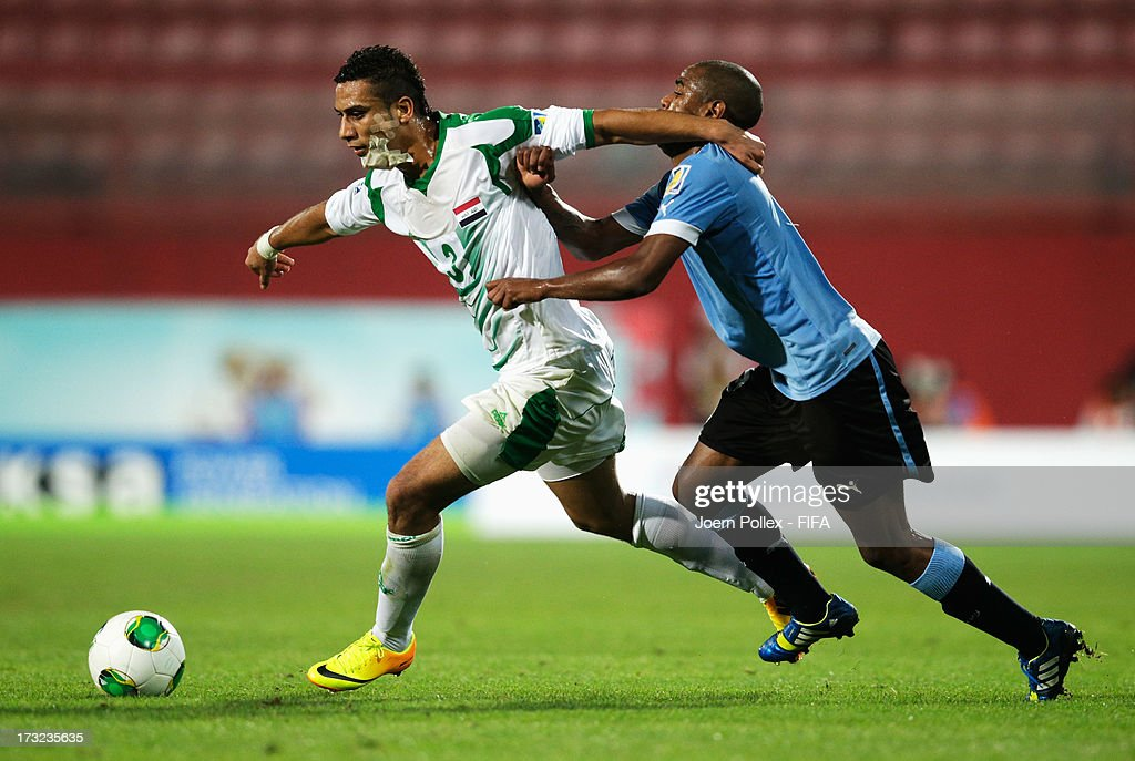 Ali Adnan (L) of Iraq and Diego Rolan of Uruguay compete for the ball during the FIFA U-20 World Cup Semi Final match between Iraq and Uruguay at Huseyin Avni Aker Stadium on July 10, 2013 in Trabzon, Turkey.
