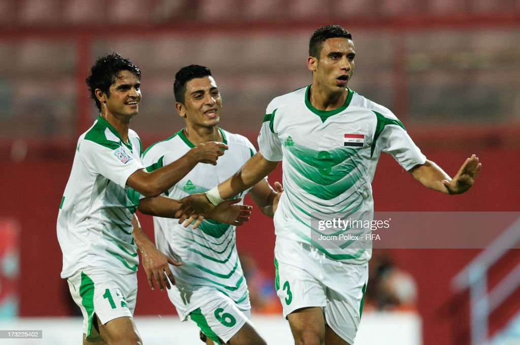 Ali Adnan (R) of Iraq celebrates with his team mates after scoring his team's first goal during the FIFA U-20 World Cup Semi Final match between Iraq and Uruguay at Huseyin Avni Aker Stadium on July 10, 2013 in Trabzon, Turkey.