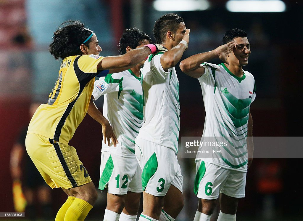 Ali Adnan (2nd R) of Iraq celebrates with his team mates after scoring his team's first goal during the FIFA U-20 World Cup Semi Final match between Iraq and Uruguay at Huseyin Avni Aker Stadium on July 10, 2013 in Trabzon, Turkey.