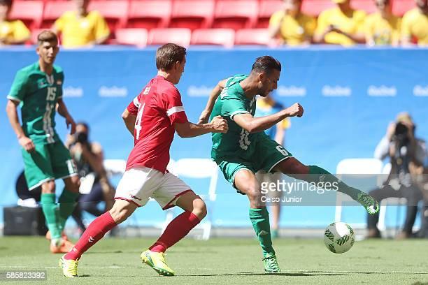 Ali Adnan of Iraq controls the ball against Casper Nielsen of Denmark at Mane Garrincha Stadium on August 4 2016 in Brasilia Brazil