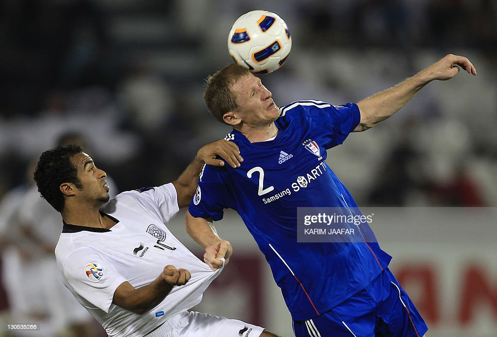 Ali Afif of Qatar's Al-Sadd club (L) challenges Mato Neretljak of South Korea's Suwon Samsung Bluewings during their AFC Champions League semi-final football match at Al-Sadd stadium in Doha, on October 26, 2011. Suwon won 1-0.