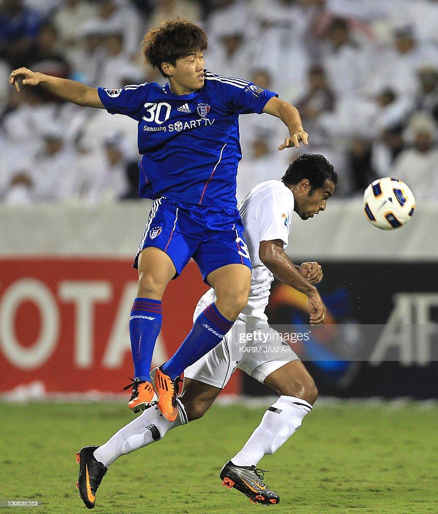 Ali Afif of Qatar's Al-Sadd club (R) challenges Sin Se Gye of South Korea's Suwon Samsung Bluewings during their AFC Champions League semi-final football match at Al-Sadd stadium in Doha, on October 26, 2011. Suwon won 1-0.