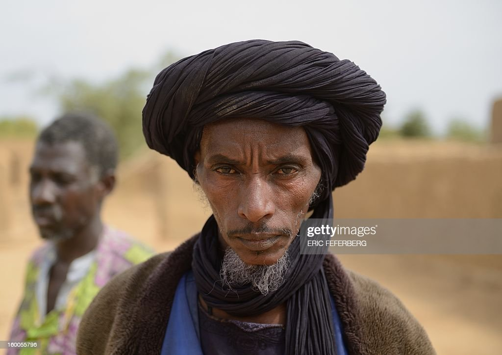 Ali Ag Noh stands on January 25, 2013 in the village of Seribala, 20 kms from Niono, about 350 kms (220 miles) northeast of the capital Bamako after his cousin, who is his wife's brother, Aboubakrim Ag Mohamed, and a cattle rancher, Samba Dicko, were both shot dead on January 24 allegedly by the Malian Army. According to Noh, Mohamed, a Tuareg, and Dicko were shot in the head in Seribala after being accused by two Malian soldiers of being Islamists or aiding Islamists. AFP PHOTO ERIC FEFERBERG