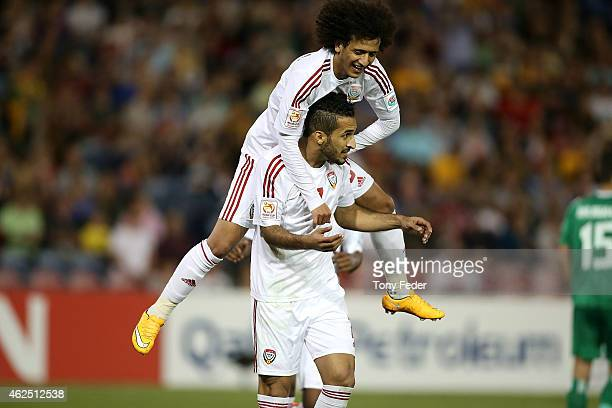 Ali Ahmed Mabkhout of the United Arab Emirates celebrates a goal with team mate Omar Abdulrahman during the Third Place 2015 Asian Cup match between...