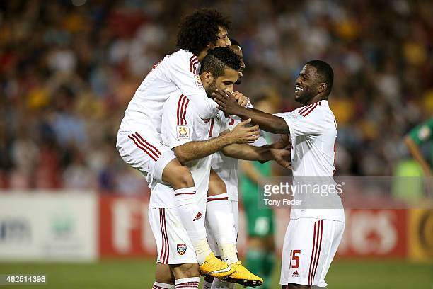 Ali Ahmed Mabkhout of the United Arab Emirates celebrates a goal with team mates Omar Abdulrahman and Ismail Al Hammadi during the Third Place 2015...