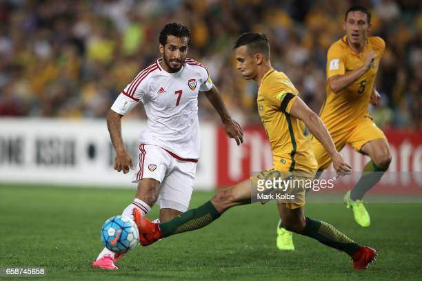 Ali Ahmed Mabkhout of the United Arab Emirates passes under pressure from Trent Sainsbury of the Socceroos during the 2018 FIFA World Cup Qualifier...