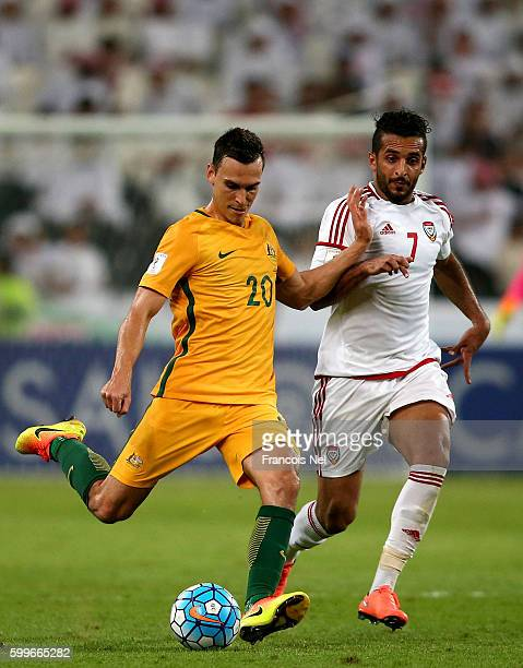 Ali Ahmed Mabkhout of UAE compete for the ball with Trent Sainsbury of Australia during the 2018 FIFA World Cup Qualifier match between UAE and...
