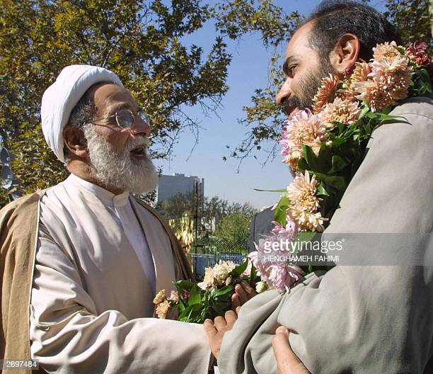 Ali Akbar Nategh Nuri a former head of parliament and now a close aide to supreme leader Ayatollah Ali Khamenei shakes hands with Iranian television...