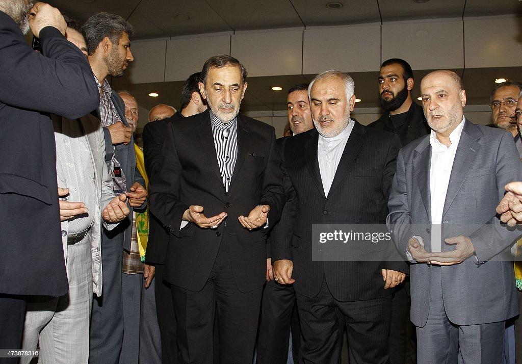 Ali Akbar Velayati advisor to the Islamic republic's supreme leader Ayatollah Ali Khamenei and Iran's ambassador to Lebanon Mohammad Fathali pray...