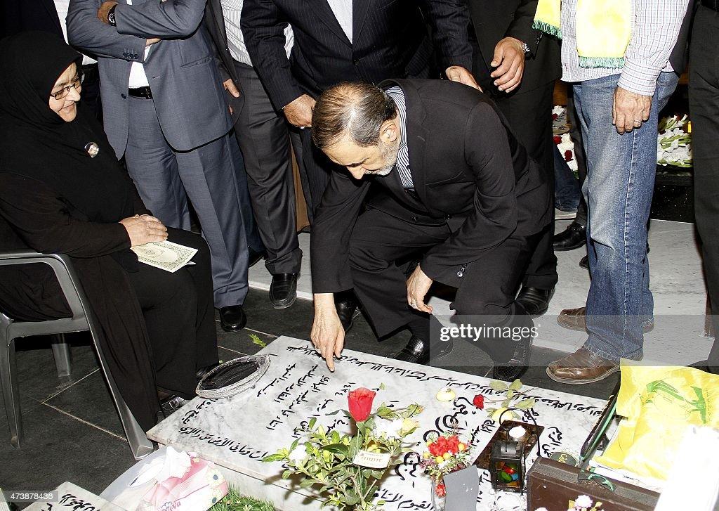 Ali Akbar Velayati advisor to the Islamic republic's supreme leader Ayatollah Ali Khamenei prays over the tomb of a Hezbollah fighter who was killed...