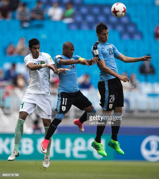 Ali Alasmari of Saudi Arabia goes up for a header with Diego de la Cruz of Uruguay and Rodrigo Bentancur of Uruguay during the FIFA U20 World Cup...
